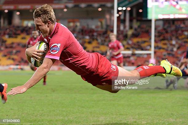 Lachlan Turner of the Reds dives over to score a try during the round 14 Super Rugby match between the Queensland Reds and the Melbourne Rebels at...