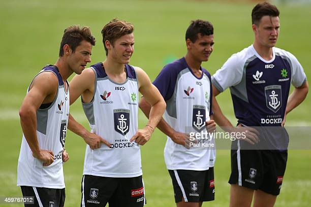Lachlan Weller and Ed Langdon of the Dockers look on during a Fremantle Dockers AFL preseason training session at Fremantle Oval on December 1 2014...