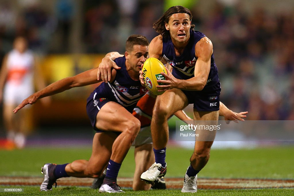 Lachlan Weller of the Dockers looks to pass the ball during the round seven AFL match between the Fremantle Dockers and the Greater Western Sydney Giants at Domain Stadium on May 7, 2016 in Perth, Australia.