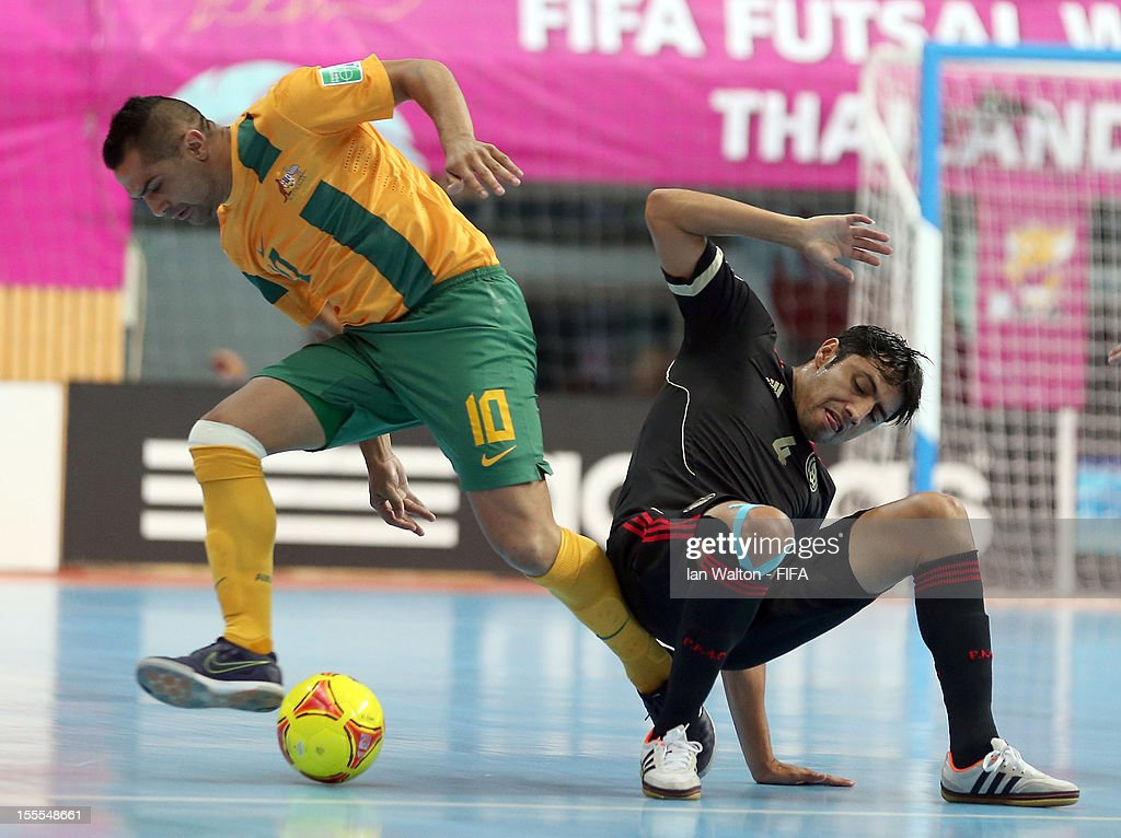 Lachlan Wright of Australia competes for the ball with Francisco Cati (R) of Mexico during the FIFA Futsal World Cup Thailand 2012, Group D match between Australia and Mexico at Nimibutr Stadium on November 5, 2012 in Bangkok, Thailand.