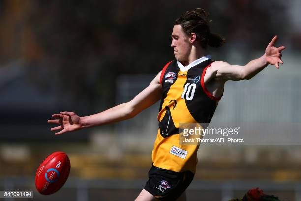 Lachlan Young of the Dandenong Stingrays kicks the ball during the TAC Cup round 18 match between Geelong and Dandenong at Victoria Park on September...