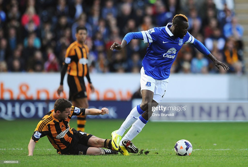 <a gi-track='captionPersonalityLinkClicked' href=/galleries/search?phrase=Lacina+Traore&family=editorial&specificpeople=6515667 ng-click='$event.stopPropagation()'>Lacina Traore</a> of Everton is tackled by Alex Bruce of Hull City during the Barclays Premier League match between Hull City and Everton at KC Stadium on May 11, 2014 in Hull, England.