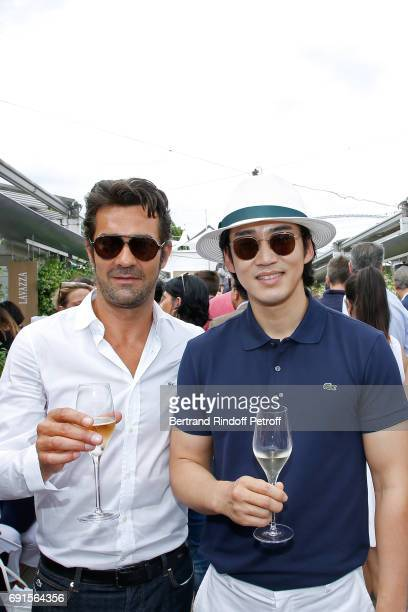 CEO Lacoste Thierry Guibert ad Korean Actor Yoon Kyesang attendthe 2017 French Tennis Open Day Six at Roland Garros at Roland Garros on June 2 2017...