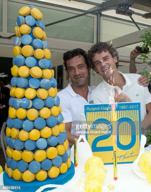 CEO Lacoste Thierry Guibert and Tennis player Gustavo Kuerten who celebrates the 20th anniversary of his first victory at Roland Garros attend the...