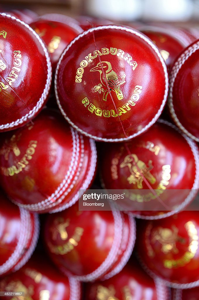 Lacquered and branded red cricket balls wait to be packaged at the Kookaburra Sports Pty Ltd. plant in Melbourne, Australia, on Tuesday, Nov. 26, 2013. Australian businesses need to boost efficiency to maintain growth in living standards, Reserve Bank of Australia Deputy Governor Philip Lowe said. Photographer: Carla Gottgens/Bloomberg via Getty Images