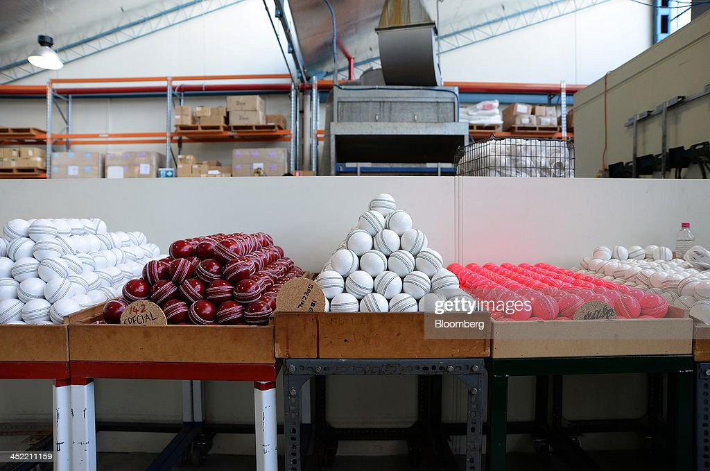 Lacquered red, white and pink cricket balls sit in crates as they await labeling at the Kookaburra Sports Pty Ltd. plant in Melbourne, Australia, on Tuesday, Nov. 26, 2013. Australian businesses need to boost efficiency to maintain growth in living standards, Reserve Bank of Australia Deputy Governor Philip Lowe said. Photographer: Carla Gottgens/Bloomberg via Getty Images