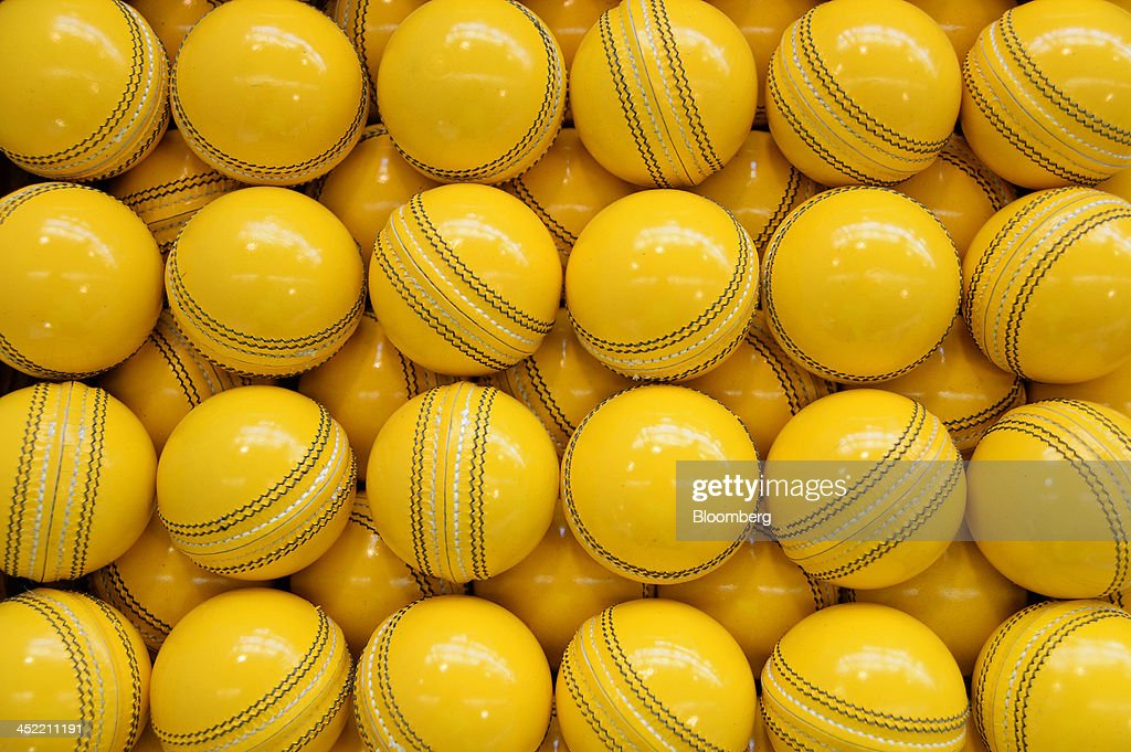 Lacquered yellow cricket balls await labeling at the Kookaburra Sports Pty Ltd. plant in Melbourne, Australia, on Tuesday, Nov. 26, 2013. Australian businesses need to boost efficiency to maintain growth in living standards, Reserve Bank of Australia Deputy Governor Philip Lowe said. Photographer: Carla Gottgens/Bloomberg via Getty Images