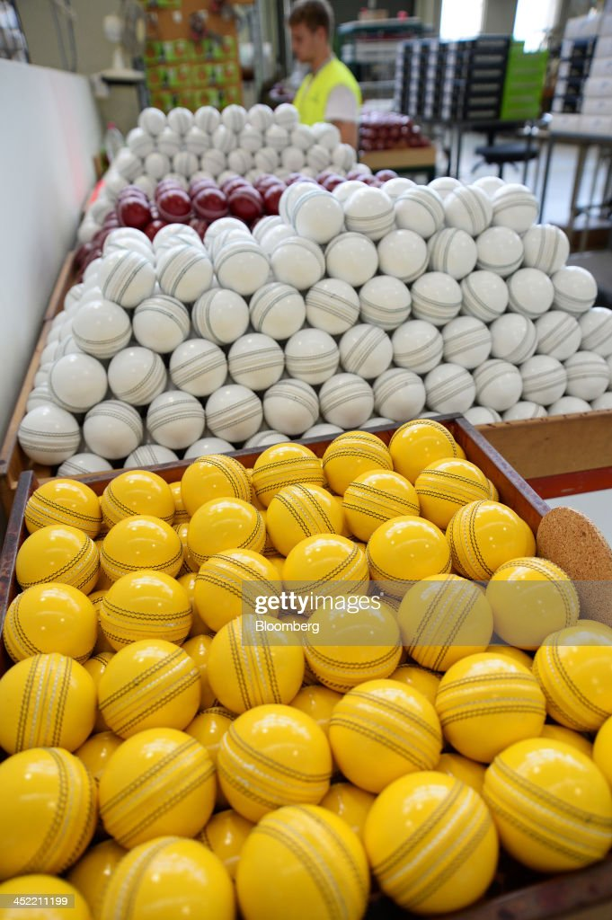 Lacquered yellow, white and red cricket balls sit in crates as they await labeling at the Kookaburra Sports Pty Ltd. plant in Melbourne, Australia, on Tuesday, Nov. 26, 2013. Australian businesses need to boost efficiency to maintain growth in living standards, Reserve Bank of Australia Deputy Governor Philip Lowe said. Photographer: Carla Gottgens/Bloomberg via Getty Images