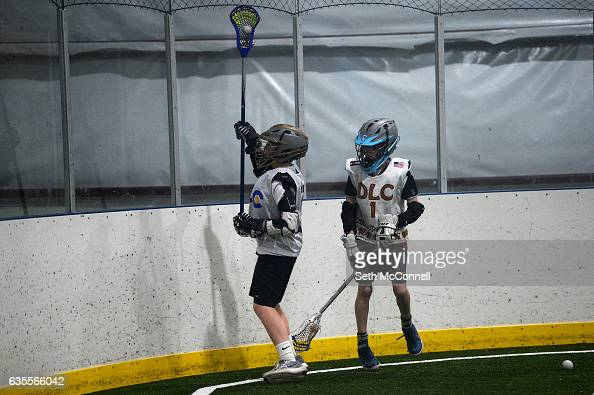 Lacrosse players battle for a loose ball during a drop in practice session at the Foothills Park and Rec Fieldhouse in Denver Colorado on February 14...