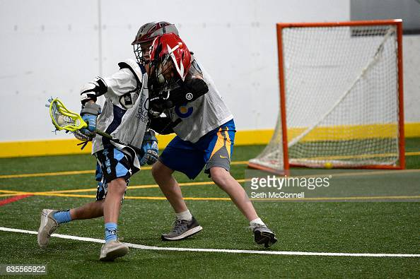 Lacrosse players battle for position in front of the net during a drop in practice session at the Foothills Park and Rec Fieldhouse in Denver...