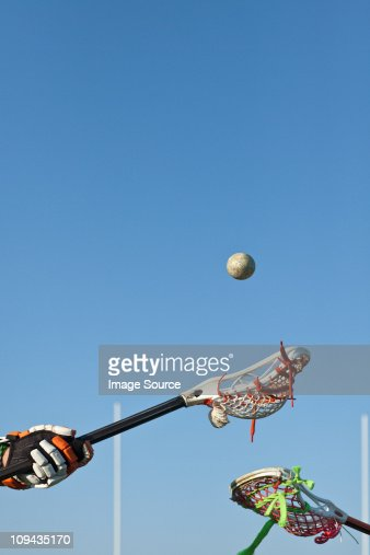 Lacrosse players competing for the ball