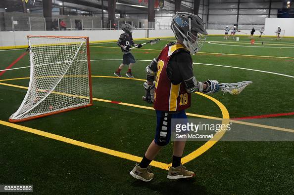 Lacrosse players set up for a drill during a drop in practice session at the Foothills Park and Rec Fieldhouse in Denver Colorado on February 14 2017...