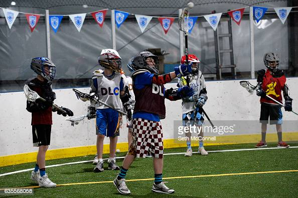 Lacrosse players toss the ball back and forth during a drop in practice session at the Foothills Park and Rec Fieldhouse in Denver Colorado on...
