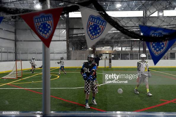 Lacrosse players warm up before a drop in practice session at the Foothills Park and Rec Fieldhouse in Denver Colorado on February 14 2017 Foothills...