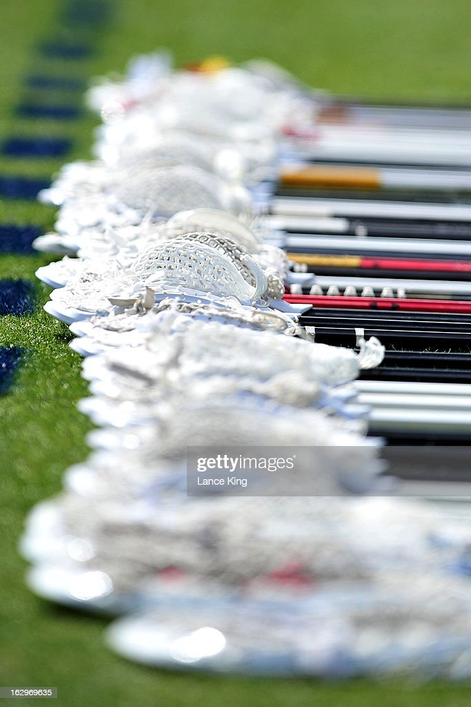 Lacrosse sticks of the Maryland Terrapins are seen on the sideline during a game against the Duke Blue Devils at Koskinen Stadium on March 2, 2013 in Durham, North Carolina. Maryland defeated Duke 16-7.