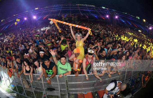 Lacy Knaffla of Nevada sits on the shoulders of Dave Levy of Nevada as they watch Empire of the Sun perform at the 17th annual Electric Daisy...