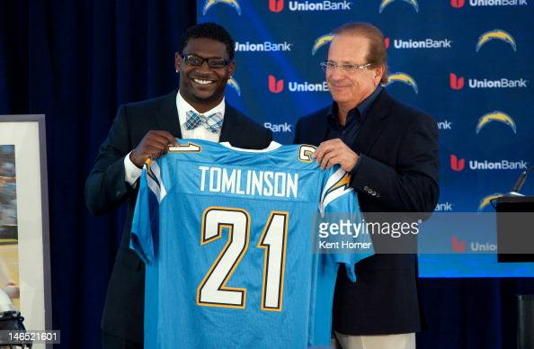 LaDainian Tomlinson holds a jersey with San Diego Chargers Dean Spanos during his announcement of his retirement from professional football after...