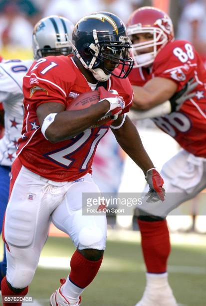 LaDainian Tomlinson of the AFC carries the ball against the NFC during the NFL Pro Bowl Game February 13 2005 at Aloha Stadium in Honolulu Hawaii The...