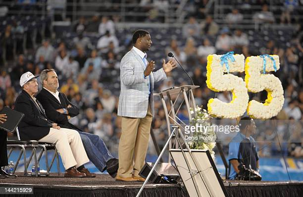 LaDainian Tomlinson speaks as Bobby Ross and Dan Fouts look on during a memorial for former San Diego Chargers star football player Junior Seau at...