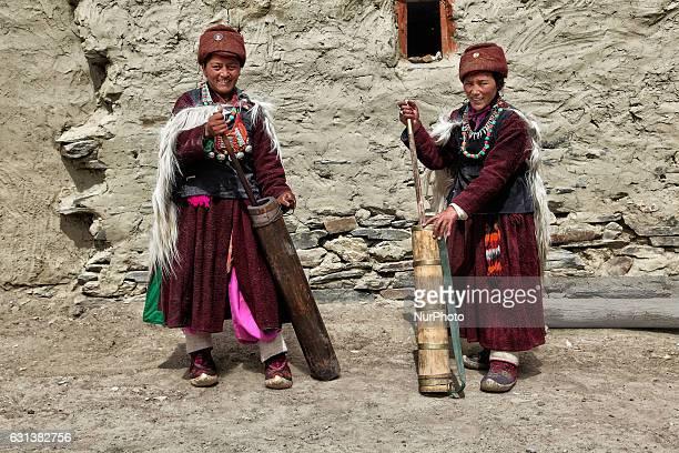Ladakhi women churning yak butter in a small Himalayan village in Zanskar Ladakh Jammu and Kashmir India