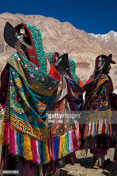 Ladakhi women wearing the traditional clothes and headdresses called Perak at the Silk Route Festival held in Sumur Ladakh Jammu and Kashmir India A...