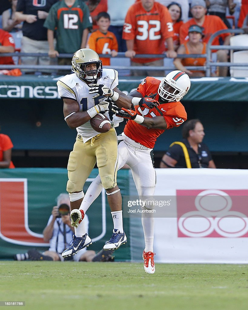 Ladarius Gunter #37 of the Miami Hurricanes breaks up the pass to DeAndre Smelter #15 of the Georgia Tech Yellow Jackets on October 5, 2013 at Sun Life Stadium in Miami Gardens, Florida. The Hurricanes defeated the Yellow Jackets 45-30.