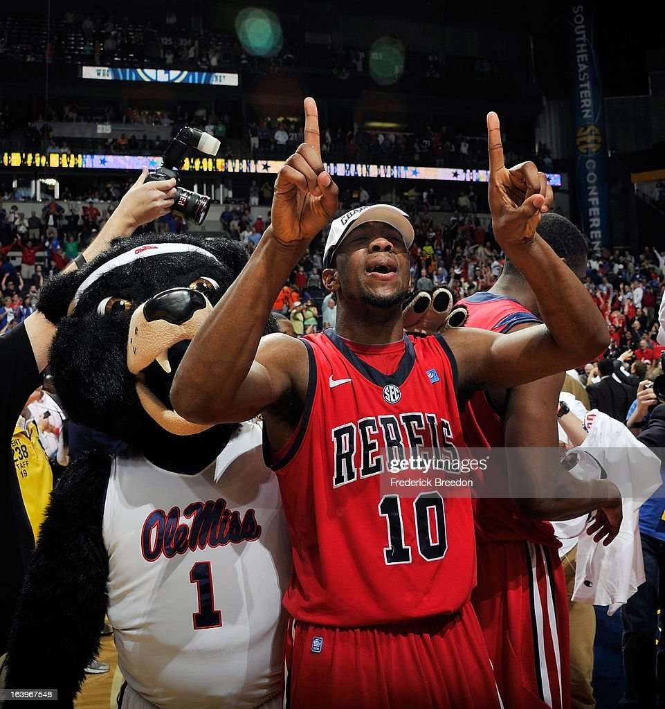 LaDarius White #10 of the Ole Miss Rebels celebrates a 66-63 victory over the Florida Gators in the SEC Baskebtall Tournament Championship Game at the Bridgestone Arena on March 17, 2013 in Nashville, Tennessee.