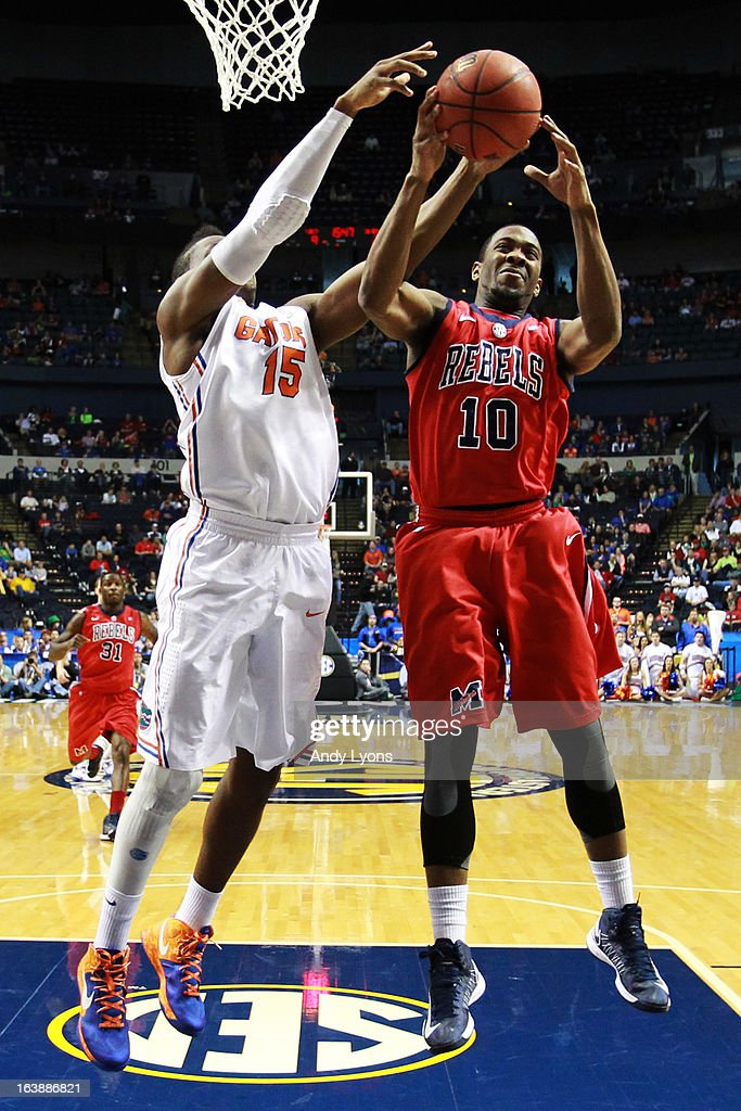 Ladarius White #10 of the Ole Miss Rebels pulls down a rebound against Will Yeguete #15 of the Florida Gators in the first half of the SEC Basketball Tournament Championship game at Bridgestone Arena on March 17, 2013 in Nashville, Tennessee.