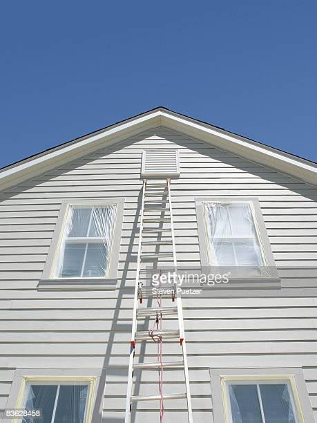 Ladder leaning against white house