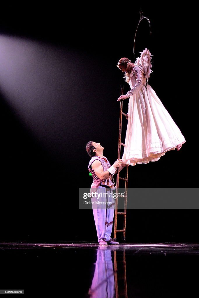 A ladder specialist amazes the audience with his unnerving balance and finesse as he performs on various ladders, trying desperately to reach the angel who is watching him from above on June 13, 2012 in Antwerpen, Belgium.