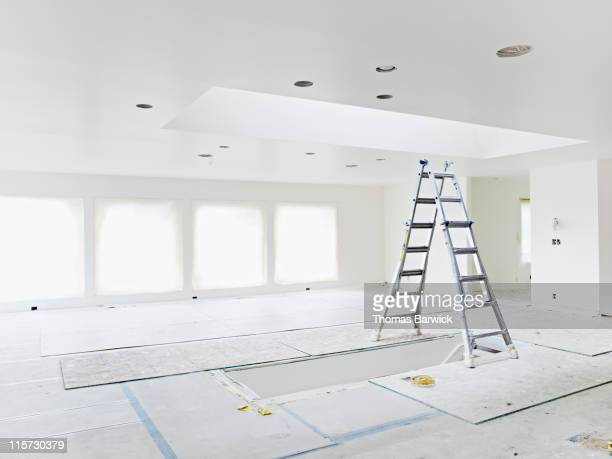 Ladder under skylight in empty home