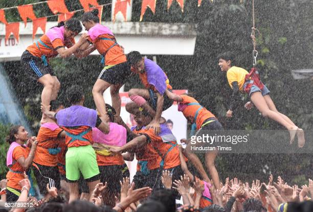Ladies and gents Govinda revellers use the safety harnesser to form human pyramid on the occasion of Gokulashtami at Prabhadevi on August 15 2017 in...