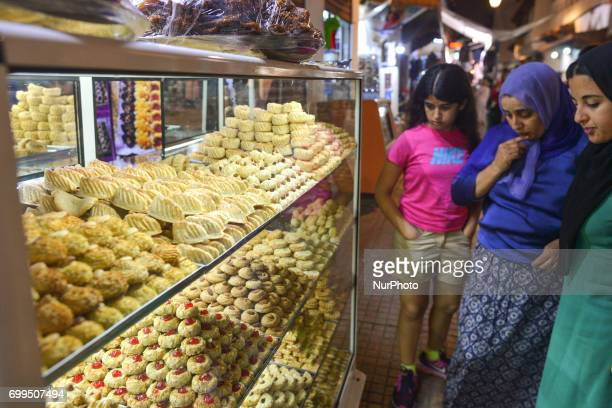 Ladies await to buy a pastry in a busy Rabat Medina main street after Iftar meal Laylat alQadr or Night of Destiny which falls on the 27th day of...