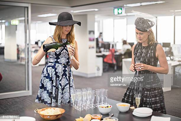 Ladies celebrating the Melbourne Cup in the offfice
