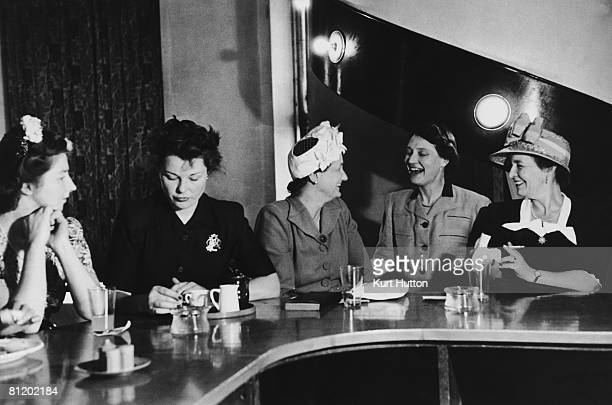 Ladies chat over their drinks at the Ladies Carlton Club in London October 1947 Original Publication Picture Post 4452 The Ladies Carlton Club pub...