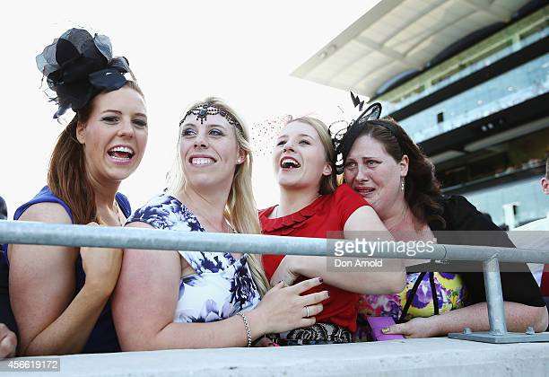 Ladies display their emotions as their horse wins the Flight Stakes at The Star Epsom Day at Royal Randwick Racecourse on October 4 2014 in Sydney...