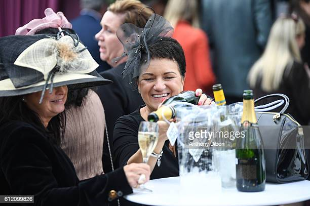 Ladies drink champagne during the Horse Racing Qatar Prix de l'Arc de Triomphe on October 2 2016 in Chantilly France