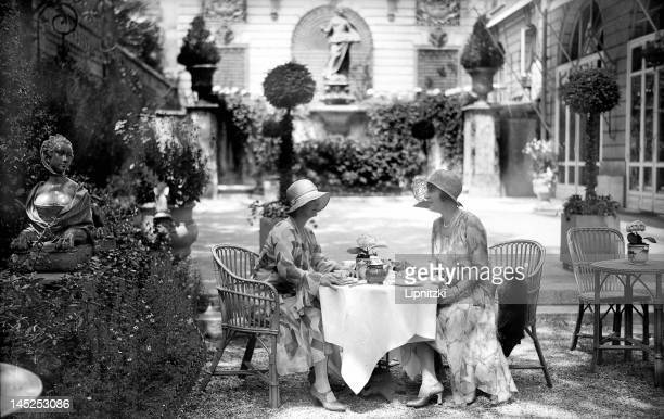 Ladies drinking tea in the garden of the Ritz Hotel Paris 1930