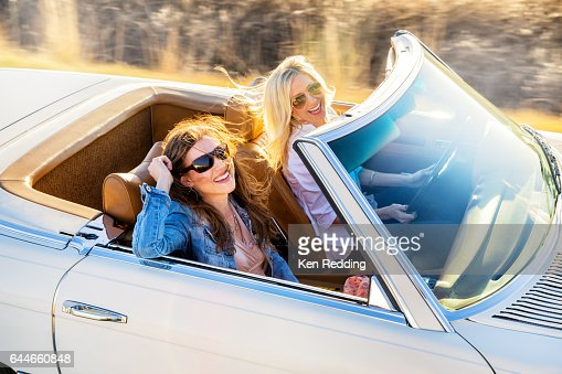 2 Ladies Driving in a Vintage Convertible : Bildbanksbilder