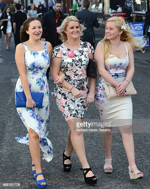 Ladies enjoy the atmosphere on Day 2 of the Aintree races at Aintree Racecourse on April 10 2015 in Liverpool England