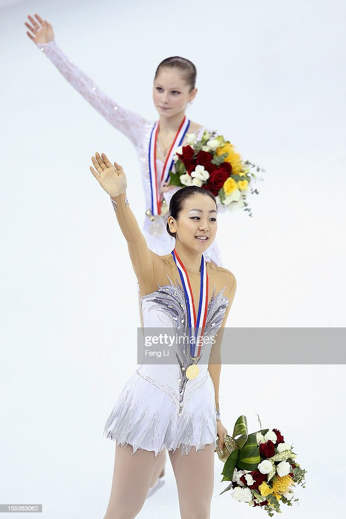 Ladies gold medalist Mao Asada of Japan and silver medalist Julia Lipnitskaia of Russia wave to fans during the medal ceremony of Cup of China ISU Grand Prix of Figure Skating 2012 at the Oriental Sports Center on November 3, 2012 in Shanghai, China.