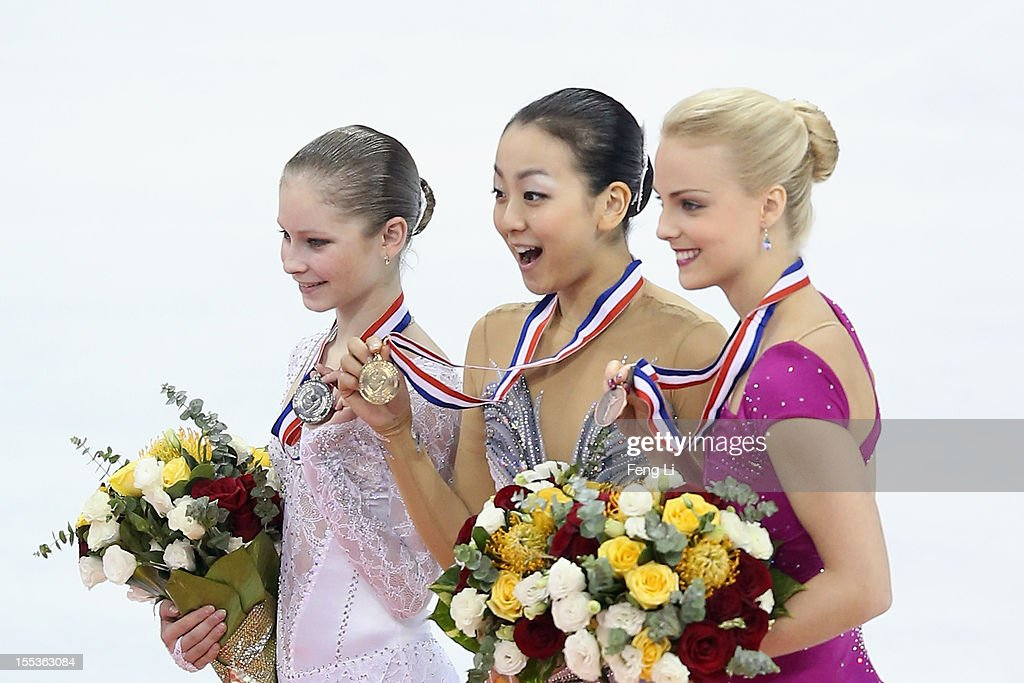 Ladies gold medalist Mao Asada of Japan (C), silver medalist Julia Lipnitskaia of Russia (L) and Kiira Korpi of Finland (R) pose for photo during the medal ceremony of Cup of China ISU Grand Prix of Figure Skating 2012 at the Oriental Sports Center on November 3, 2012 in Shanghai, China.