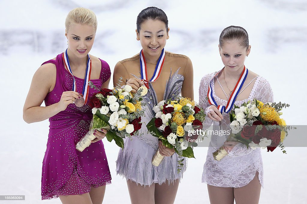 Ladies gold medalist Mao Asada of Japan (C), silver medalist Julia Lipnitskaia of Russia (R) and Kiira Korpi of Finland (L) pose for photo during the medal ceremony of Cup of China ISU Grand Prix of Figure Skating 2012 at the Oriental Sports Center on November 3, 2012 in Shanghai, China.