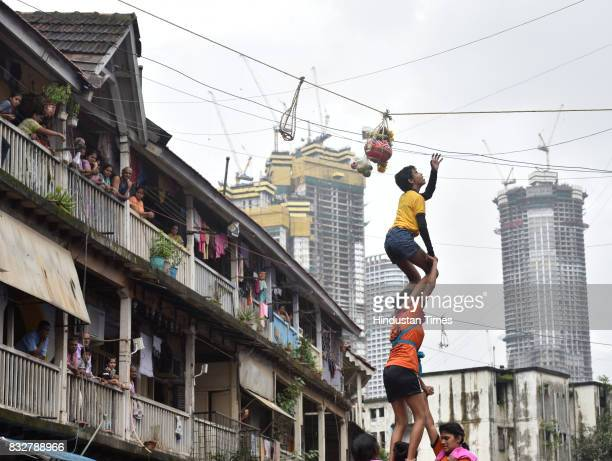Ladies Govinda revellers form human pyramid on the occasion of Gokulashtami at Prabhadevi on August 15 2017 in Mumbai India The childgod Krishna and...