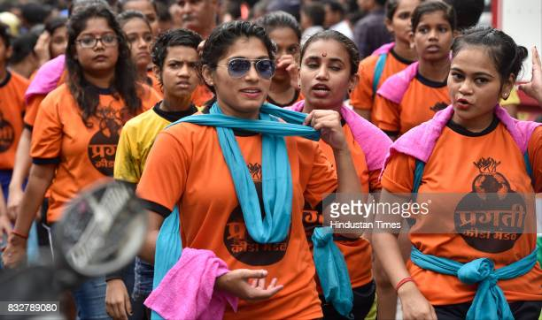 Ladies Govinda revellers from human pyramid on the occasion of Gokulashtami at Prabhadevi on August 15 2017 in Mumbai India The childgod Krishna and...