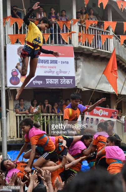 Ladies Govinda revellers use the safety harnesser to form human pyramid on the occasion of Gokulashtami at Prabhadevi on August 15 2017 in Mumbai...
