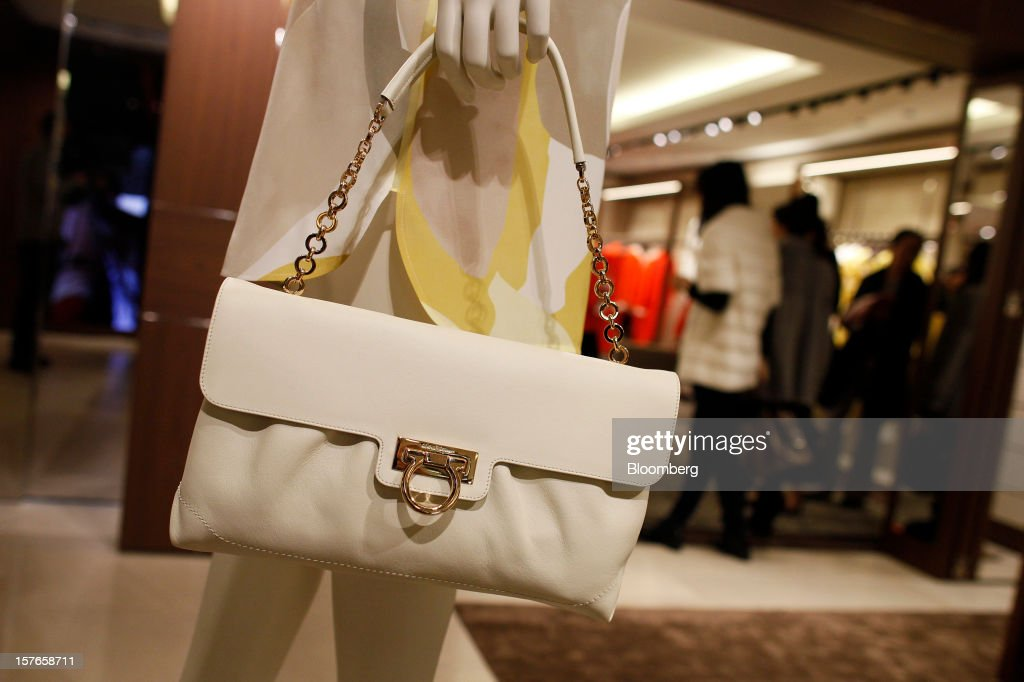 A ladies handbag hangs from a mannequin inside Salvatore Ferragamo SpA's Sloane Street store in London, U.K., on Wednesday, Dec. 5, 2012. Demand for Ferragamo's shoes and other items is increasing even as China's economy slows and Europe's debt crisis weighs on consumer spending. Photographer: Simon Dawson/Bloomberg via Getty Images