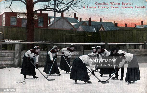 A ladies hockey team is practicing in this colored photographic postcard issued mid 1900s in Toronto Ontario Canada