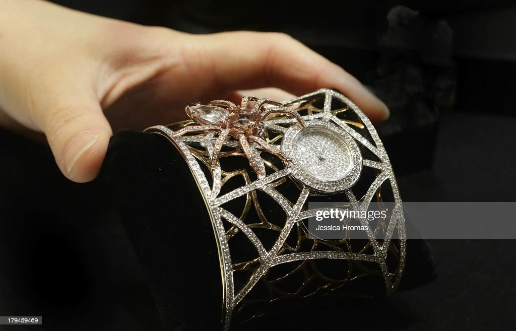 A ladies jewellery watch in 18 carat gold set with diamonds and semi precious stones in the style of a spider on a web, valued at USD $30,000, is sdisplayed at the Artis Jewellery Co Limited stand at the Hong Kong Watch & Clock Fair on September 4, 2013 in Hong Kong, Hong Kong.