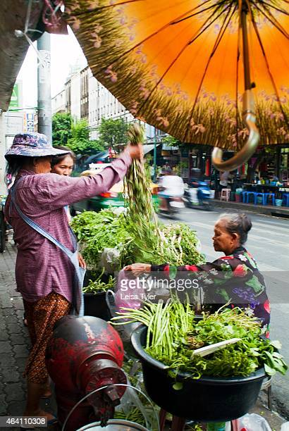 Ladies selling river weeds on the street side in Bangkok Although the prolification of supermarkets has seen a rapid demise in the number of fresh...
